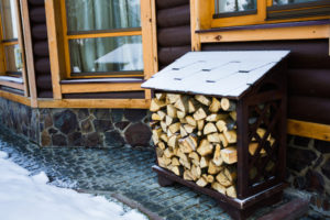 winter pest prevention: move your firewood to an elevated platform away from the home
